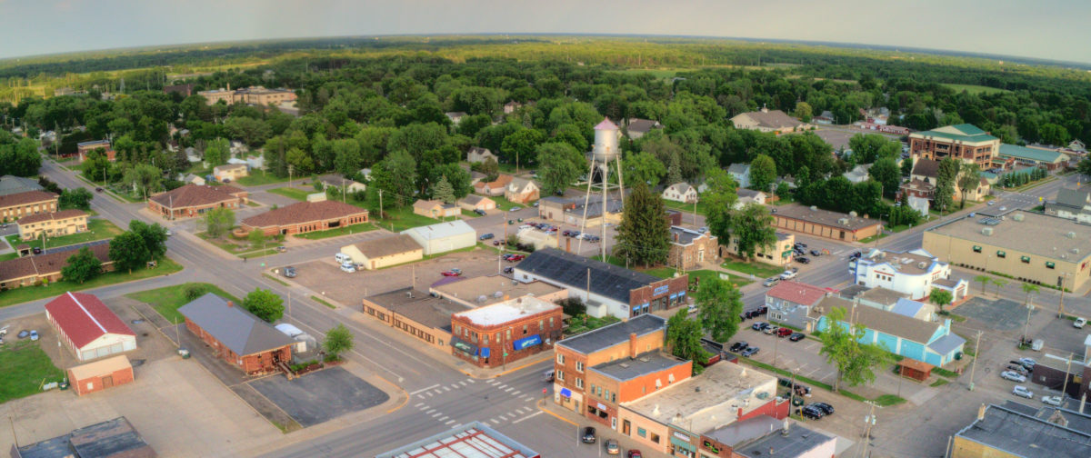 Aerial shot of small town with water tower