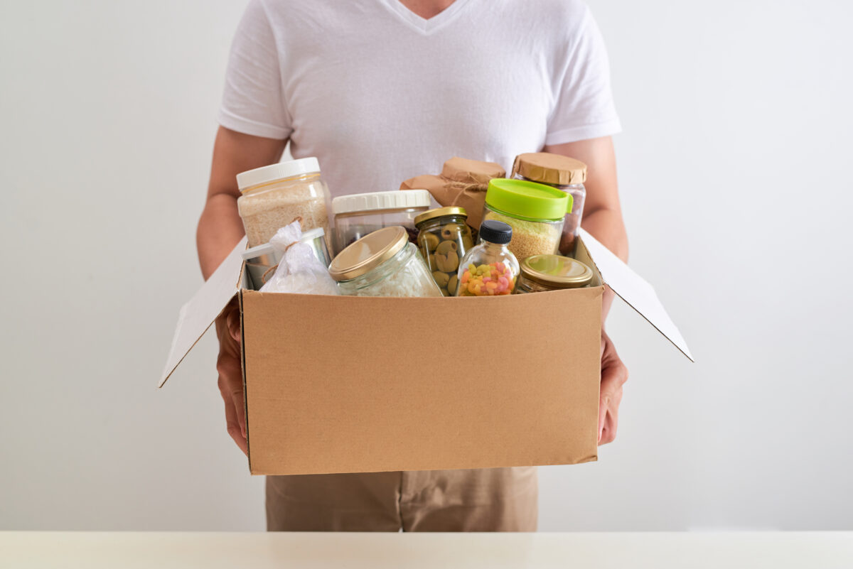 man holding box of food