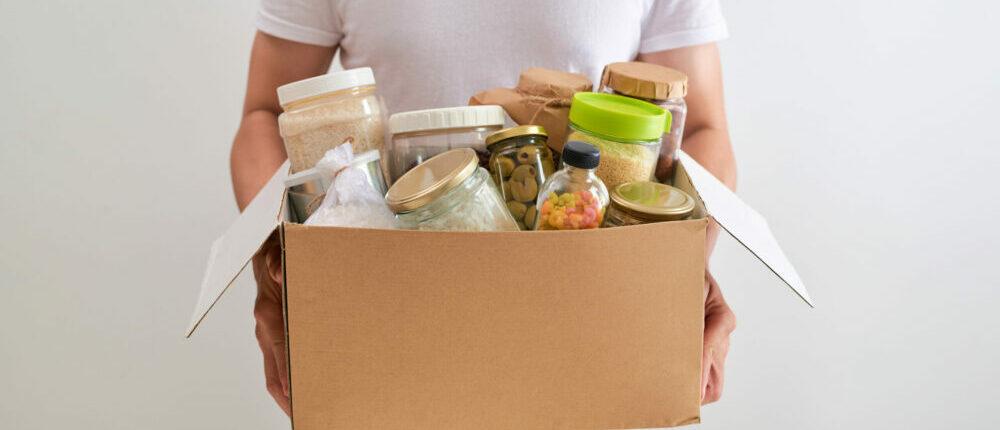 man holding box of food